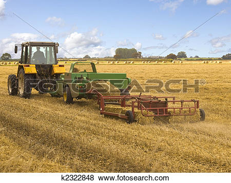 Pictures of baling machine and tractor k2322848.
