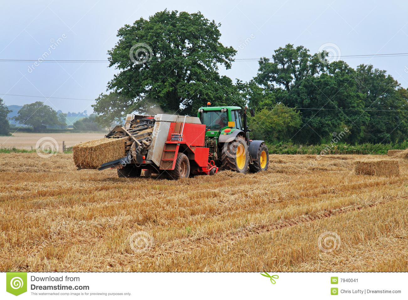 Tractor And Baling Machine Stock Image.