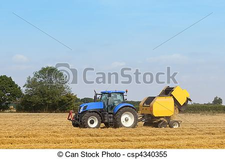 Stock Images of blue tractor and baling machine.