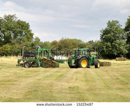 Tractor Hay Baler Stock Photos, Royalty.