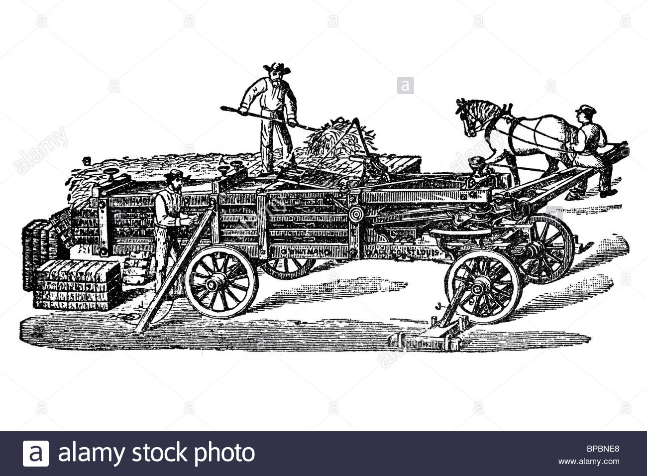 Old Hay Baler. Machine Moved By Animal Traction. Antique Stock.