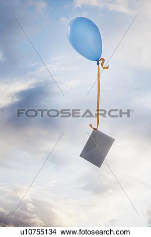 Stock Photo of Balloon tied to an envelope u10755134.
