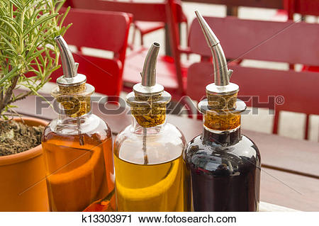 Stock Photography of balsamic vinegar bottles and condiments on.