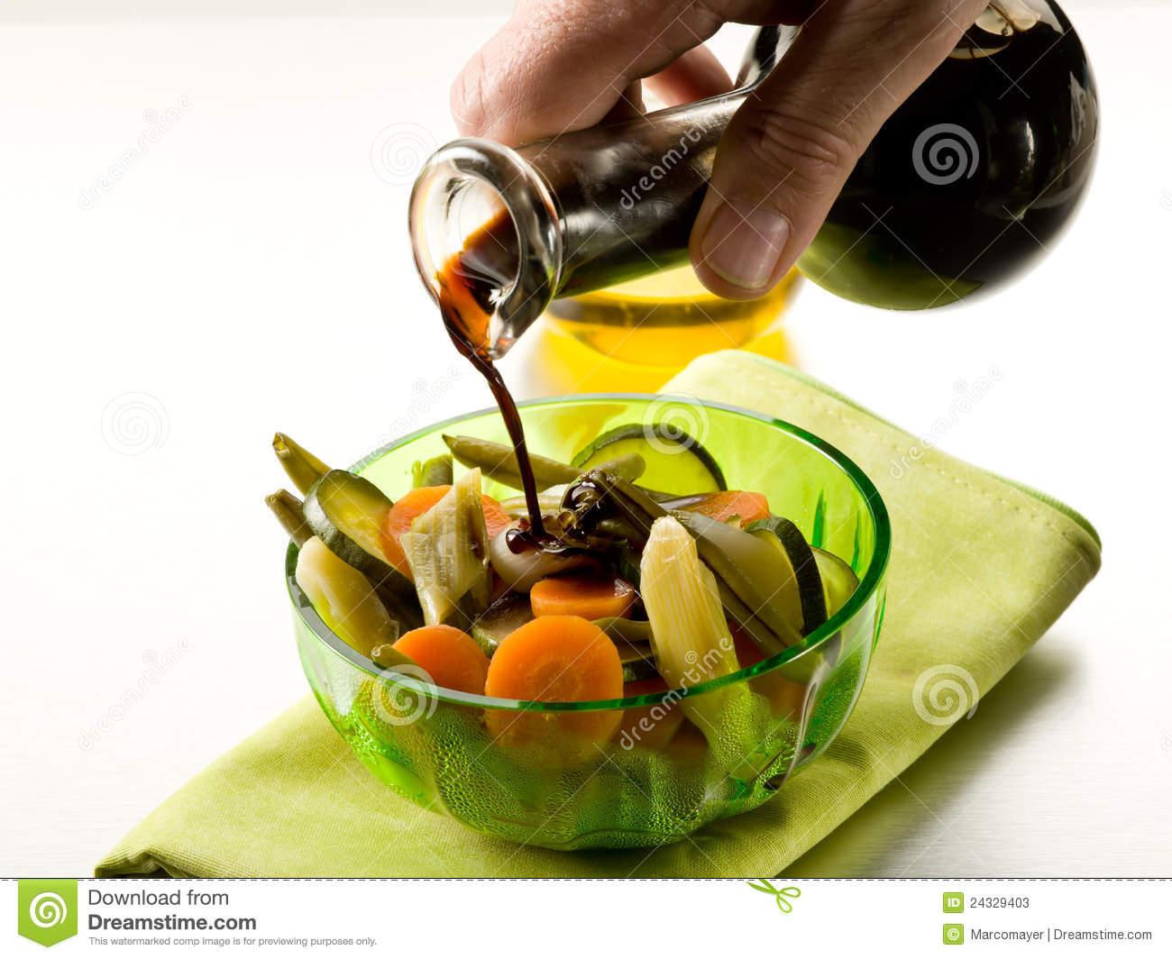 Pouring Balsamic Vinegar Stock Photos.