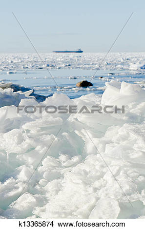 Stock Photo of Pile of broken ice floes on the Baltic Sea coast.