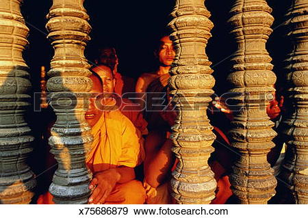 Stock Photograph of Cambodia,Angkor,Temple,worshippers looking.