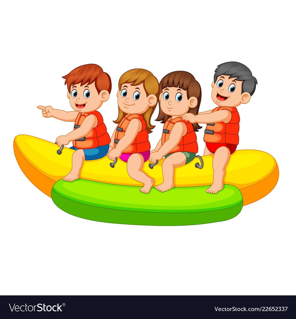 Happy kids ride on banana boat.