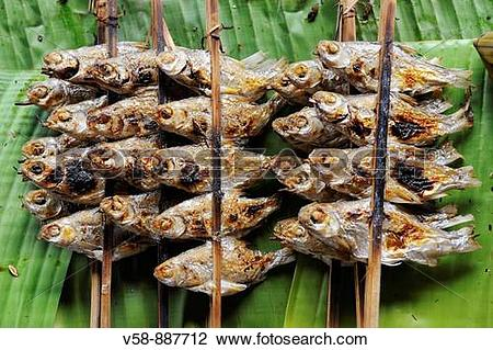 Stock Photo of River fish sold on banana leaves, Muong Khua market.