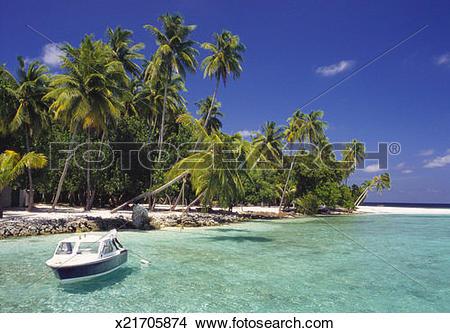 Stock Photo of Boat Moored Off the Coast of Kuda Bandos, North.