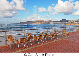 Stock Photography of Open air cafe at ocean beach, Bandos Island.