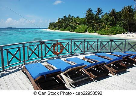 Stock Photographs of Sunbed at timber pier, Maldives, Bandos.