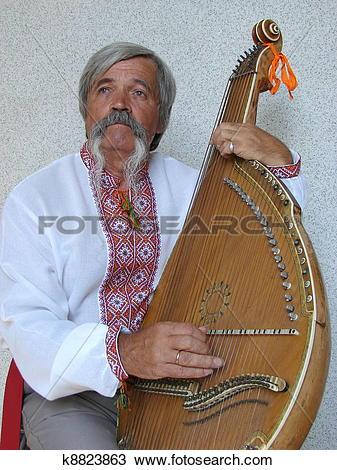 Stock Photo of Senior ukrainian traveling musician named kobzar.