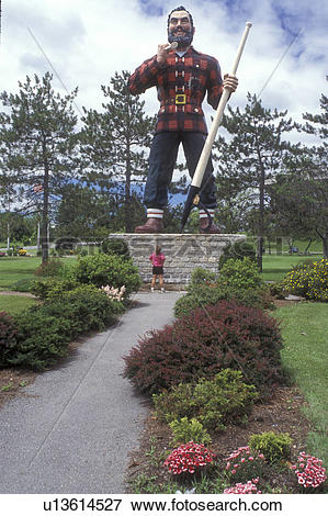 Picture of Bangor, Maine, Paul Bunyan, A woman stands below the.