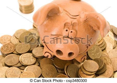 Stock Photography of Pig bank seat on a heap of coins. Close up.