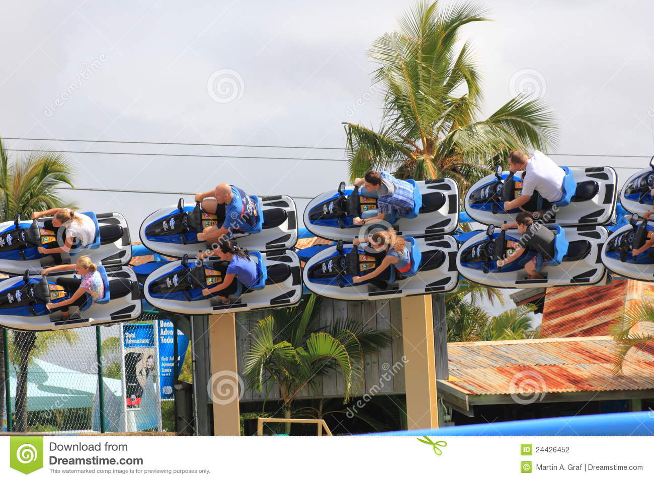 Speeding Roller Coaster Ride In Banked Turn Editorial Photography.