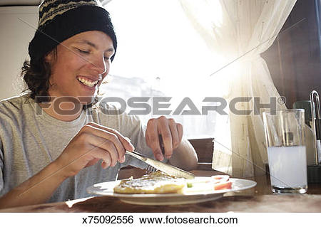 Stock Images of Young Male Skier Enjoying Food In Bansko Chalet.