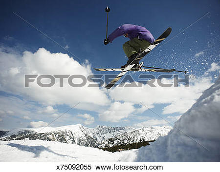 Stock Image of Young Male Skier Catching Air Off Bansko Cornice.