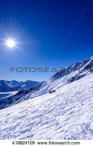 Stock Photograph of Winter mountain landscape against the blue sky.