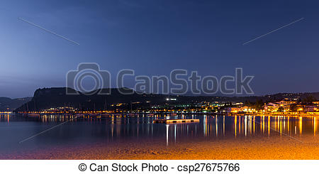 Stock Image of village bardolino italy at night with reflections.