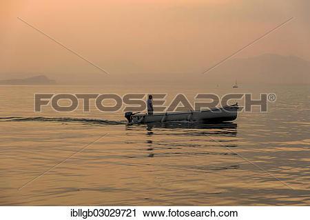 "Stock Photography of ""Fisherman driving his fishing boat on Lake."