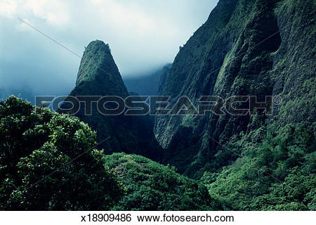 Stock Images of Thin greenery on mountain slope, bare rock face of.