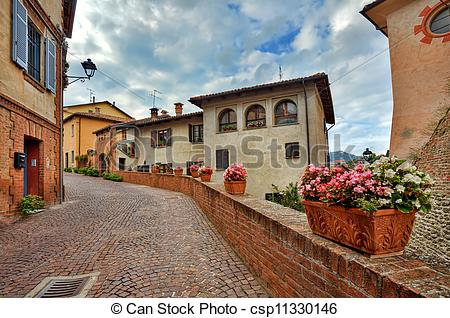 Stock Photo of Old houses and narrow street Barolo, Italy.