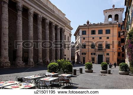 Stock Image of Hadrian's Temple, Rome, piazza and restaurant, with.
