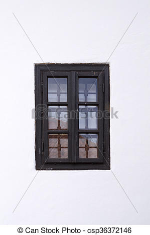 Stock Photo of Old barred window on white wall. Architectural.