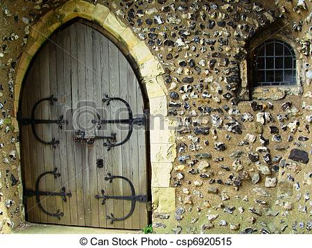 Stock Images of An Old Door and Tiny Barred Window.