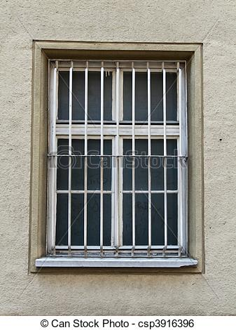 Stock Image of Barred window of a prison.