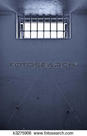 Stock Images of old prison cell with barred window k3275906.