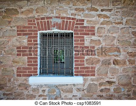 Stock Photography of barred jail window.