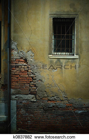 Stock Photo of Crumbling Wall with Barred Window and Pipe, Venice.