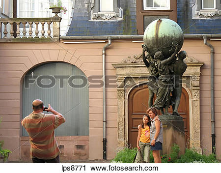 Stock Photography of family taking pictures in front of grands.