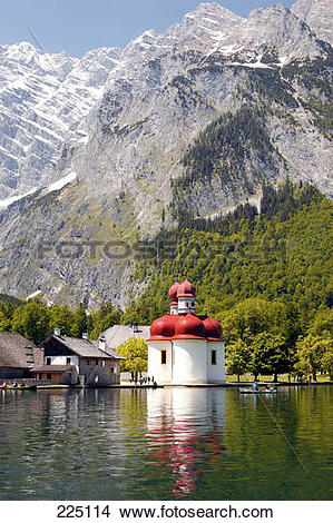 Stock Photo of Church at the waterfront with mountains in the.
