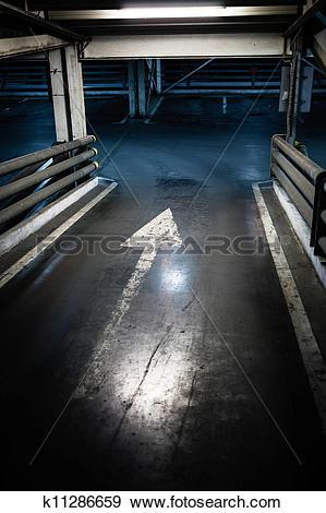 Stock Photograph of Parking garage in basement, underground.