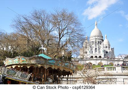 Stock Photo of Old carousel and Basilique Sacre Coeur in Paris.