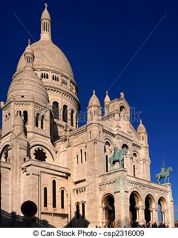 Stock Photographs of Basilique du Sacre Coeur with great blue sky.