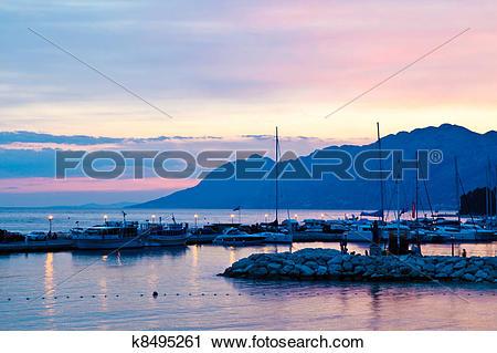 Stock Photography of Sunset at Marina in Baska Voda, Croatia.