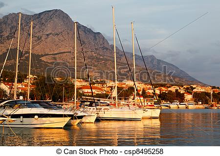 Pictures of Adriatic Sunset and Marina in Baska Voda, Croatia.