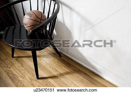Stock Photography of Basket ball in black captains chair u23470151.