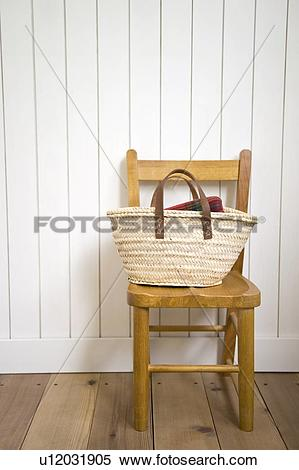 Stock Image of Basket on chair u12031905.
