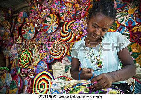 Stock Image of Basket maker with colourful basket ware; Axum.