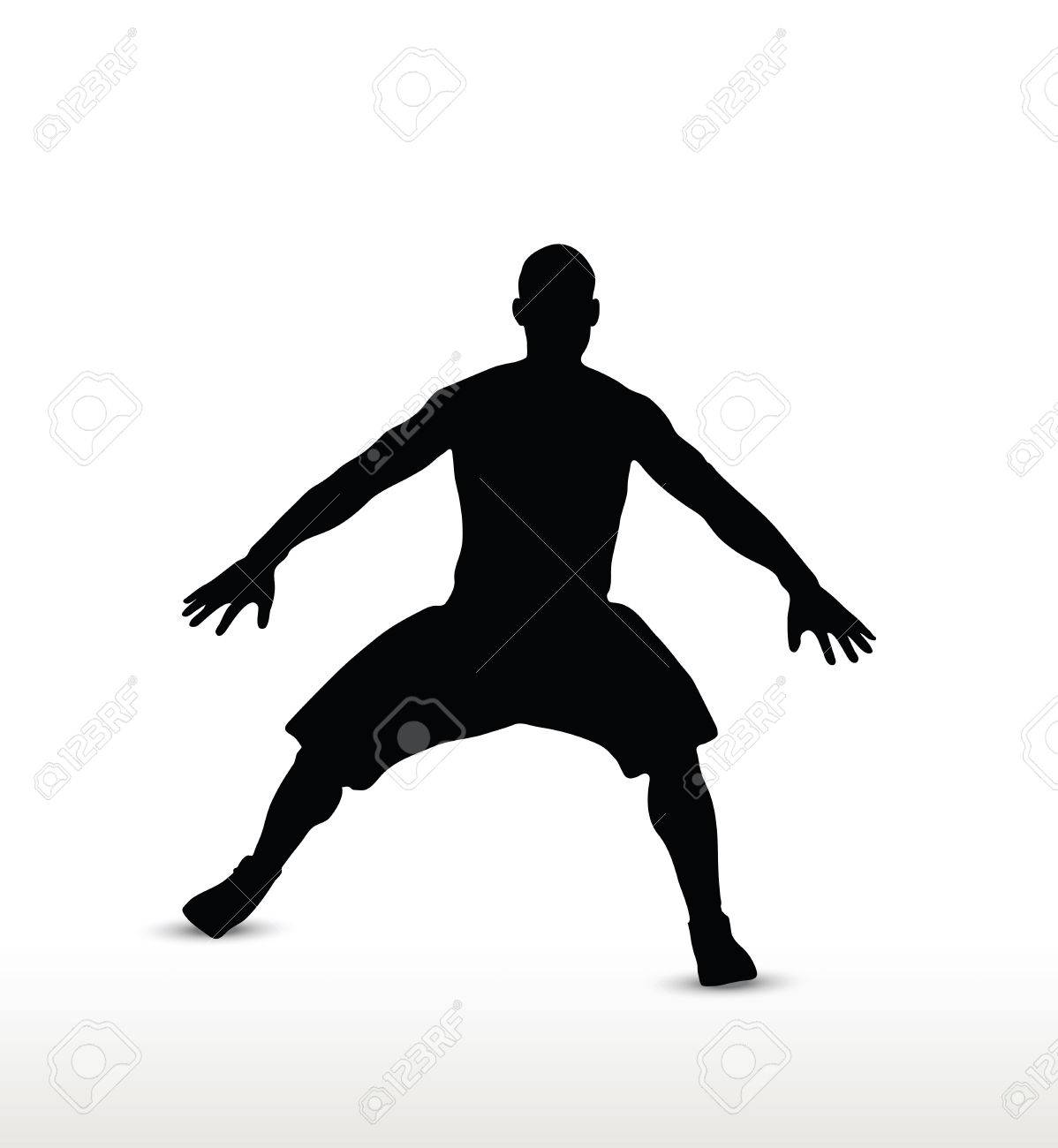 basketball player silhouette in defense pose, isolated on white...