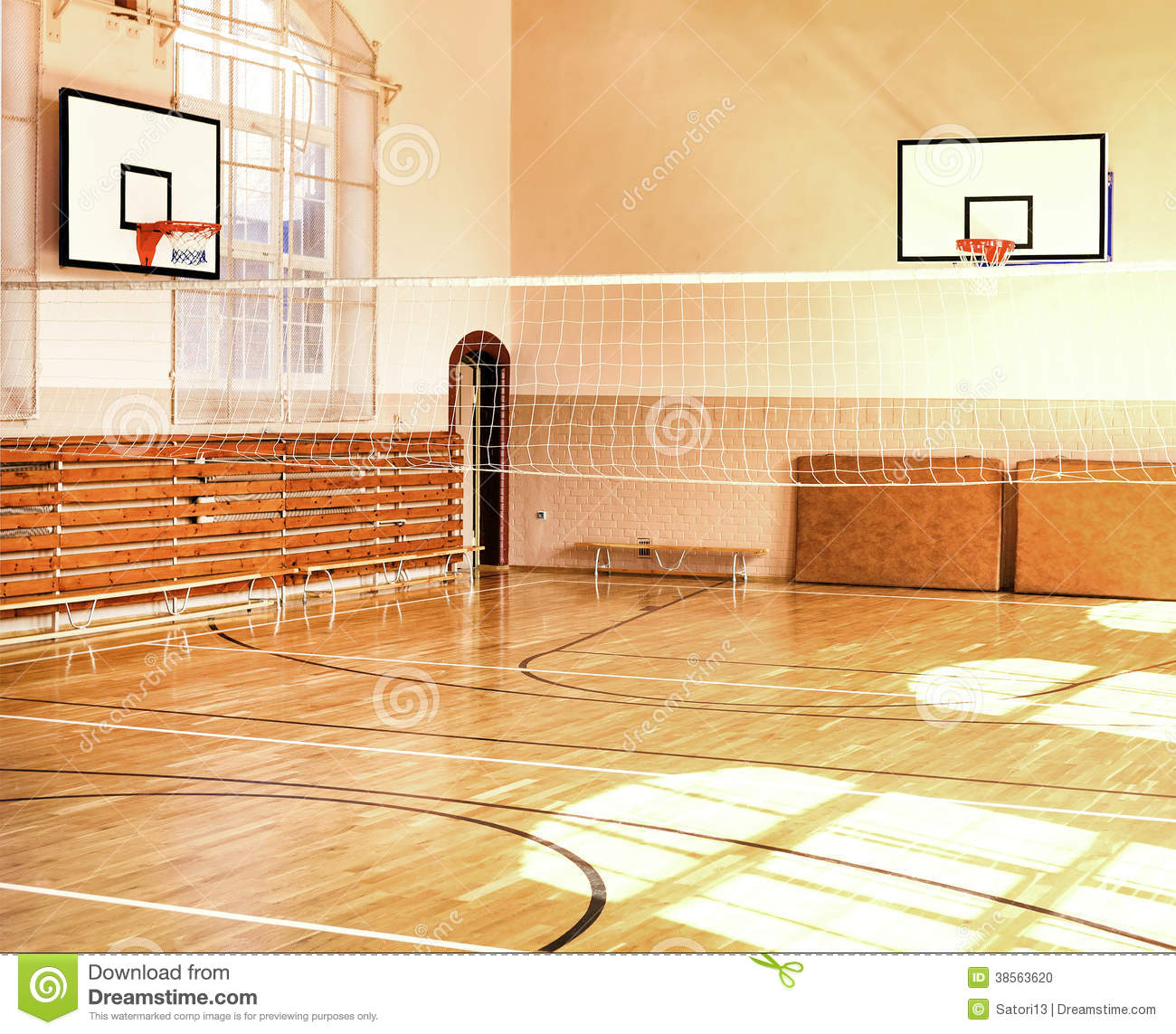 Empty School Gym With Basketball Boards Stock Photo.