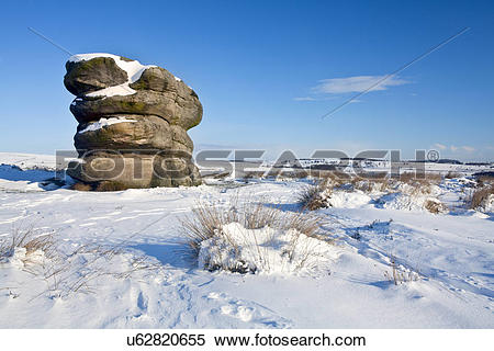 Stock Image of England, Derbyshire, Baslow Edge. The Eagle Stone.