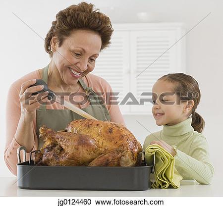 Stock Photography of Hispanic grandmother and granddaughter.