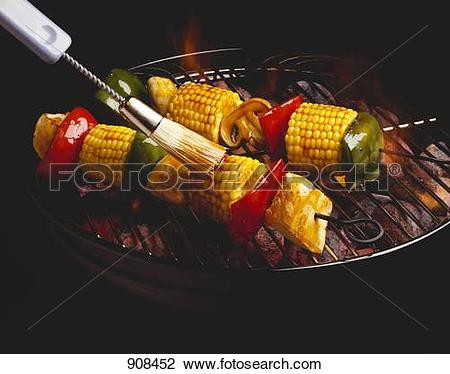 Stock Photo of Basting Chicken and Vegetable Kabobs on the Grill.