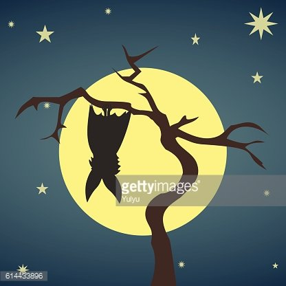 Silhouette bat hanging on a dry tree Clipart Image.