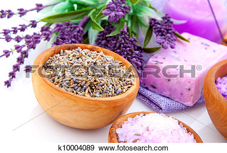 Stock Photograph of dry Lavender herbs and bath salt isolated on.